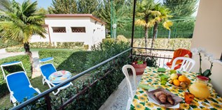 Luxuscamping - Hunde erlaubt - Peschiera del Garda - Bungalow Butterfly auf Camping Butterfly